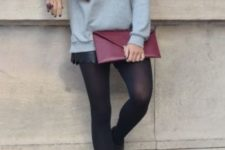 06 an embellised grey sweater, black leather shorts, tights and booties