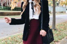 07 a burgundy mini skirt, a white shirt with a black bow, a black velvet blazer and tights