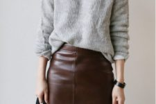 07 a maroon leather skirt and a grey sweater can be worn to work if there's no strict dress code
