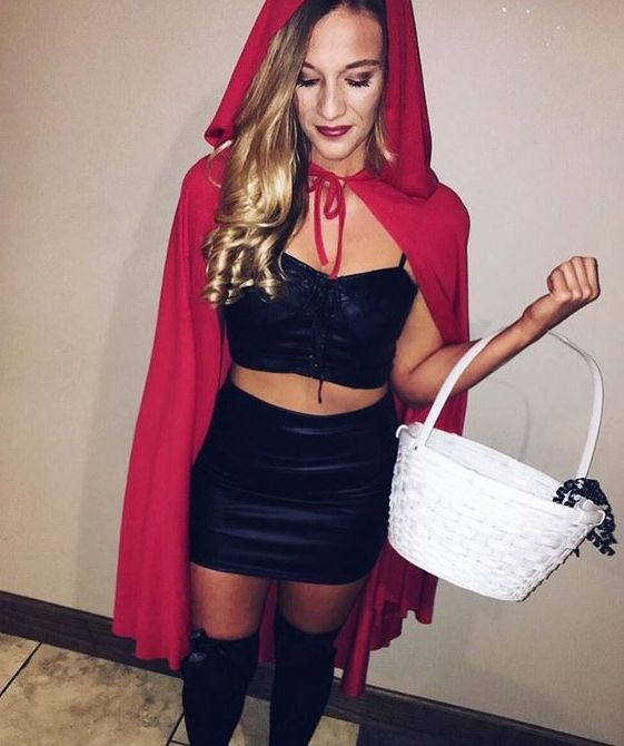 Little Red Riding Hood with a black top, a black mini skirt, black stockings, a red hood