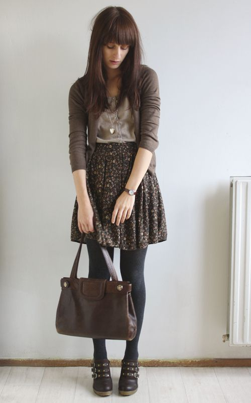 a brown floral skirt, black tights, brown booties, a neutral top and a brown cardigan for a vintage inspired look