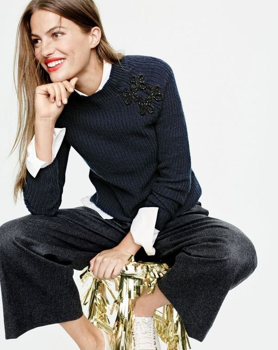 black culottes, a white shirt, a navy embellished sweater