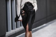 08 black suede booties, a white oversized sweater, a black leather skirt with a slit