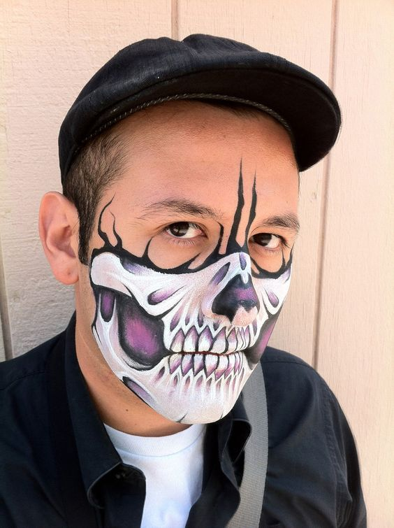 purple skull makeup for half face looks interesting and eye-catchy