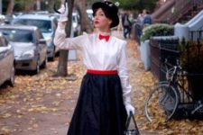 Mary Poppins costume with a black skirt, a white shirt, a red sash and a bow tie, black shoes and a black hat