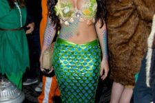 09 a sexy mermaid look with a shell and star fish bra and a sparkling tail skirt