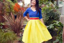 10 Snow White costume with a red midi skirt, a blue sweater with a matching shirt, bold yellow heels and a headband