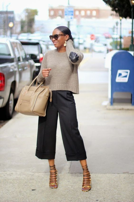 black culottes, a neutral sweater, strappy shoes and a neutral bag