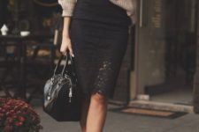 11 a black lace pencil skirt, a brown oversized sweater, white heels and a black bag