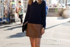 11 a navy sweater over the shirt, a brown leather skirt, red flats and a clutch