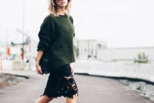 12 a dark green slouchy sweater, a black lace knee skirt and black heels