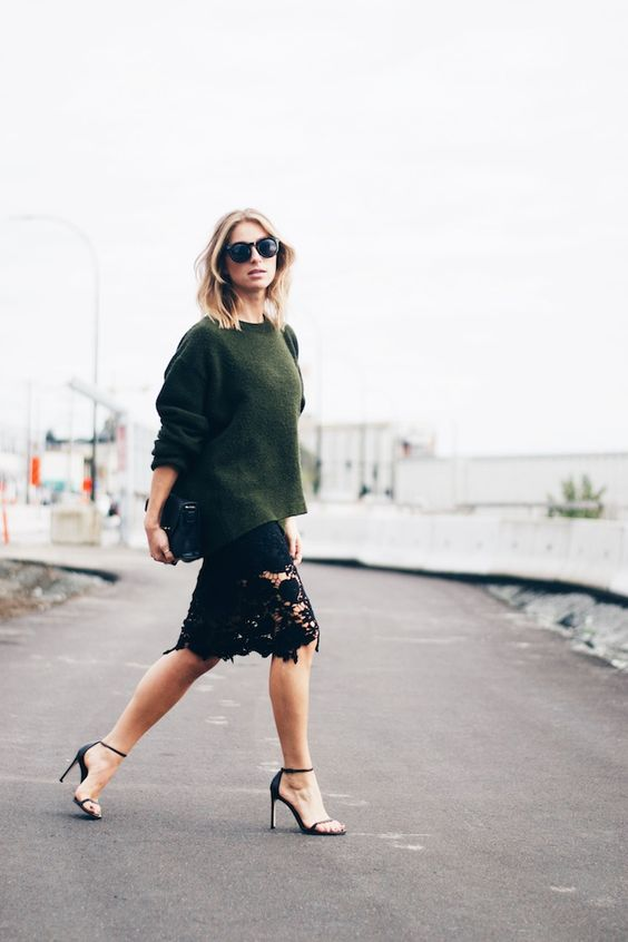 a dark green slouchy sweater, a black lace knee skirt and black heels