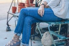 12 blue jeans, grey lace up flats and a neutral textural top