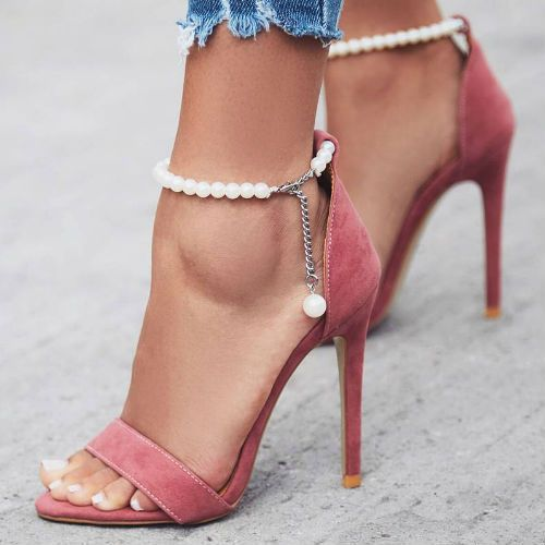 pink heeled sandals with a strand of pearls for a feminine look