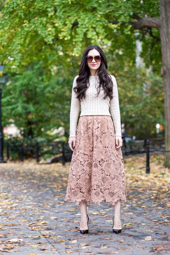 a dusty rose midi lace skirt, a neutral sweater and black shoes for a feminine look