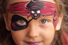 13 girl's pirate makeup with a painted headband and eyeband