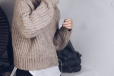 14 black leather pants, a white shirt, a neutral chunky knit sweater for a cozy casual look