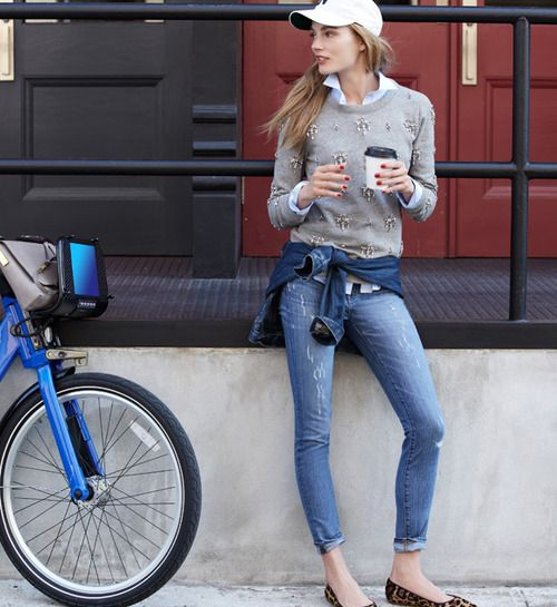 cuffed jeans, a blue shirt, a grey embellished sweater and leopard flats