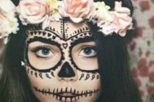 14 gorgeous sugar skull makeup done with black face paint and a floral headband