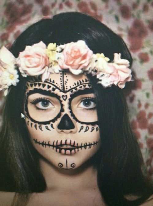 gorgeous sugar skull makeup done with black face paint and a floral headband