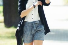 14 grey shorts, a white shirt with black buttons, a black blazer and a bag