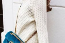 15 a white sweater, a lace white mini skirt and a teal suede bag for a colorful touch