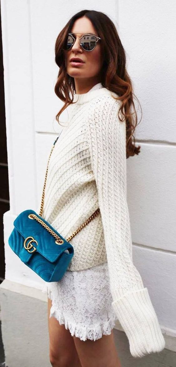 a white sweater, a lace white mini skirt and a teal suede bag for a colorful touch