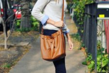 15 navy jeans, a neutral jumper over a blue shirt, amber booties and a bag