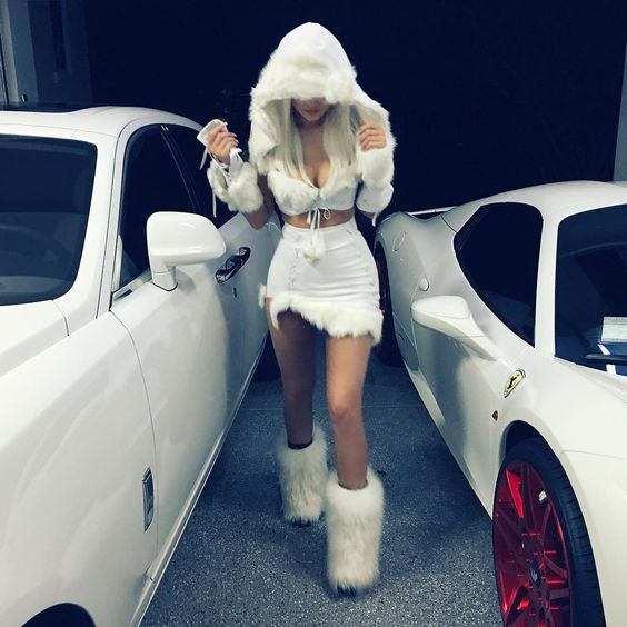 original, sexy snow princess look with a faux fur skirt, boots and a cropped hoodie