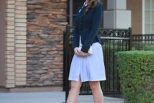 16 Kate Middleton cotume with nude shoes, a blue dress, a navy jacket and a whimsy hat