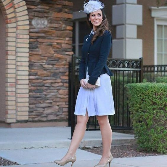 Kate Middleton cotume with nude shoes, a blue dress, a navy jacket and a whimsy hat