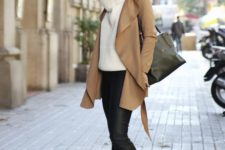16 black leather pants, heeled booties, a white chunky knit sweater and a camel coat