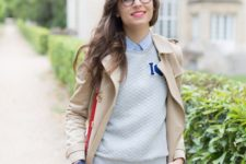 16 navy scallop shorts, a neutral sweater over a blue striped shirt and a beige trench