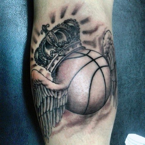 Ball with crown and wings tattoo