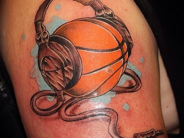 Ball with headphones tattoo