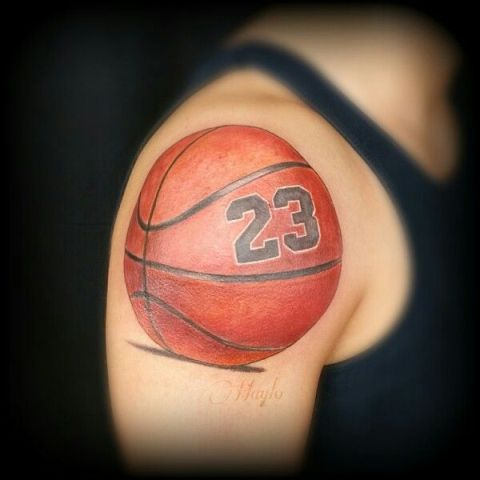 Ball with number tattoo on the shoulder