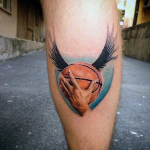 Ball with wings tattoo on the leg
