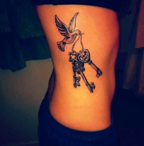Bird with three keys tattoo on the side