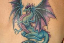 Blue and purple dragon tattoo on the back
