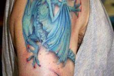 Blue dragon tattoo on the arm