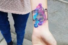Blue, purple and pink tattoo on the wrist