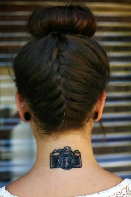 Camera tattoo on the neck