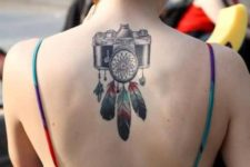 Camera with colorful feathers tattoo on the back