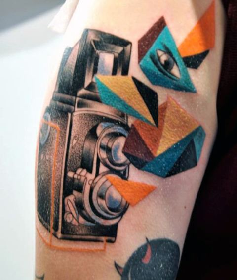 Camera with colorful geometric elements tattoo