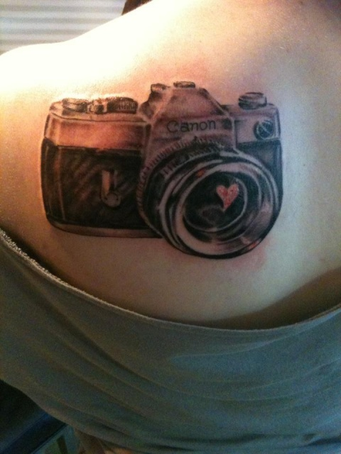 Camera with red heart tattoo on the back