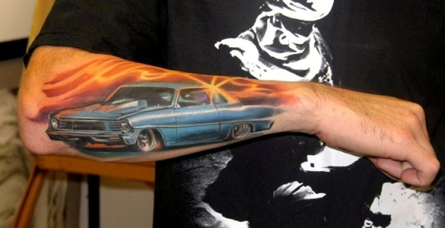 Car and sunset tattoo on the forearm
