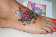 Cartoon turtle tattoo on the foot