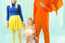 a blue fish costume for the mom, an orange octopus for the dad and a little orange fish cotume for the girl