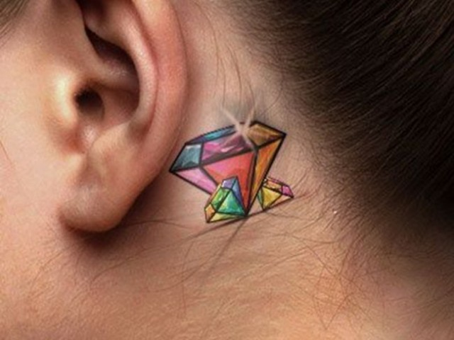 Colorful tattoo behind the ear