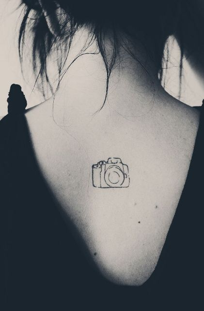 Cool camera tattoo on the back